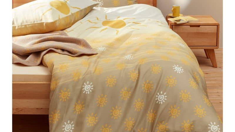 Biber Bettwäsche 155x220 Sonnenschein mit großen und kleinen Sonnen im Farbverlauf von weiß bis beige